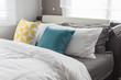 colorful pillows on white bed in modern bedroom