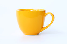 Yellow Coffee Cup On White Bac...