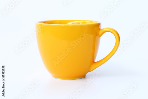 Yellow coffee cup on White background. Canvas-taulu