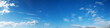 Leinwandbild Motiv Vibrant color panoramic sky with cloud on a sunny day. Beautiful cirrus cloud. Panorama high resolution photograph.