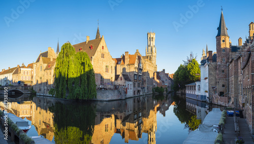Belgium, West Flanders (Vlaanderen), Bruges (Brugge). Belfort van Brugge and medieval buildings on the Dijver canal from Rozenhoedkaai at dawn.
