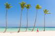 Juanillo Beach (playa Juanillo), Punta Cana, Dominican Republic. Woman walking on a palm-fringed beach (MR).