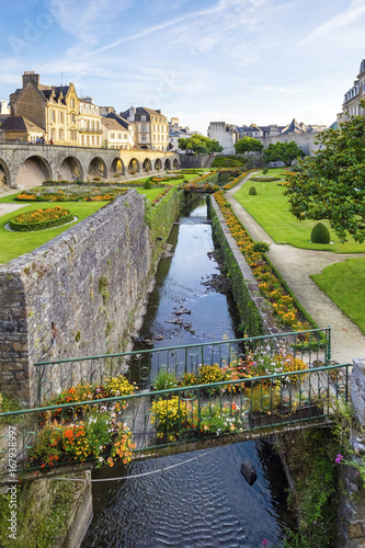 France, Brittany (Bretagne), Morbihan department, Vannes. The Marle River runs through the Jardins des Remparts gardens in front of Chateau de l'Hermine.