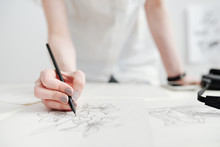 Female Illustrator Drawing Sketches
