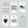 Christmas and New Year gift tags. Cards xmas set with hand drawing elements. Collection of holiday paper label in black and white. Seasonal badge sale design. Texture. Print. Vector illustration.