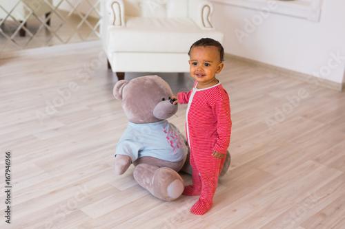 Fototapeta Cute little boy at home. Mixed race child. obraz na płótnie
