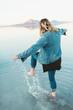 A woman splashing her foot in the great salt lake