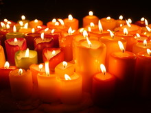 Close Up Of Red Burning Candles.