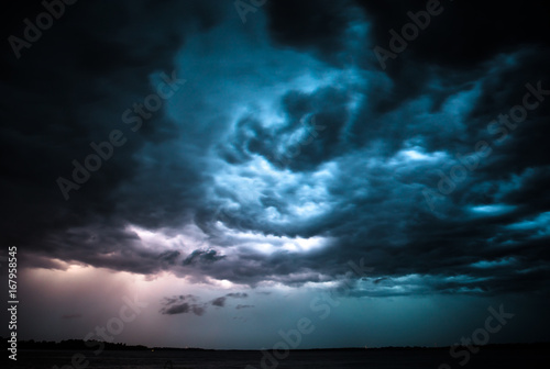 Photo  Dramatic thunderstorm.