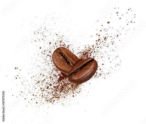 Obraz na plátně  Two coffee beans collide in the air on white background