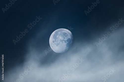 Fotografie, Obraz  Moon with light clouds in its waning gibbous phase during morning