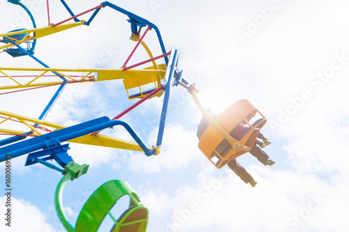 Foto op Plexiglas Amusementspark People in amusement park ride. Adult man and with kid in theme park having fun.
