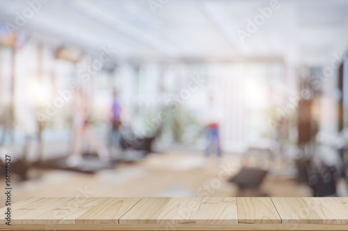 Poster Fitness Empty wood table space platform and fitness gym background. Product display montage Concept.