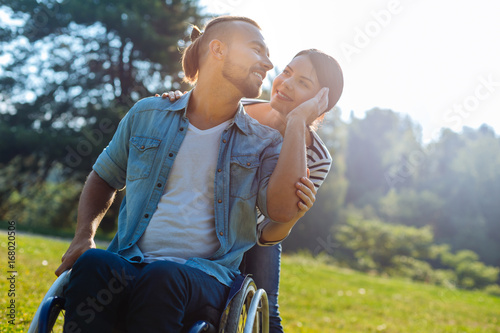 Fotografia  Smiling man with disabilities caressing his wifes cheek