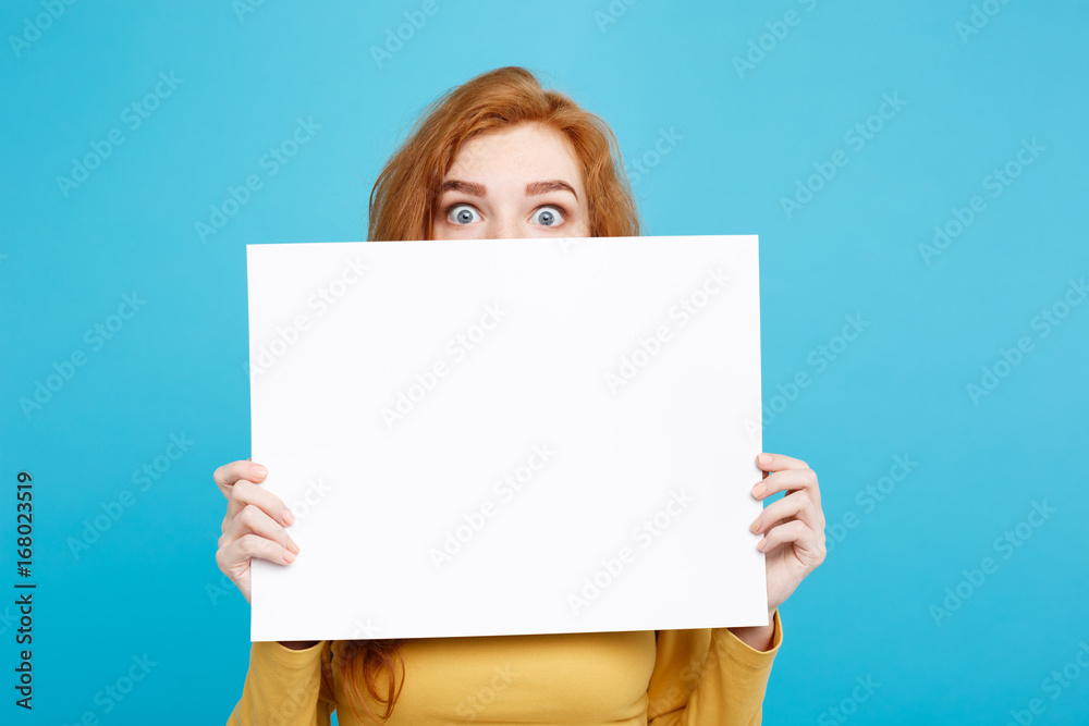 Fototapety, obrazy: Close up Portrait young beautiful attractive ginger red hair girl smiling showing blank sign. Blue Pastel Background. Copy space.