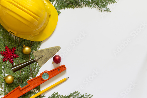 Fotografia, Obraz  Protective helmet, mason tools  and Christmas decorations on  white background