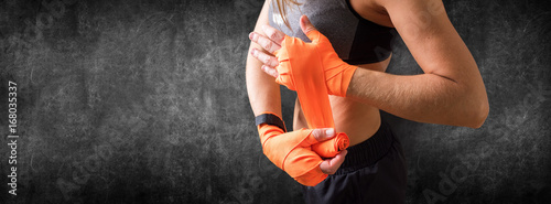 Tuinposter Vechtsport Hands of Female Fighter Wearing Boxing Bandages