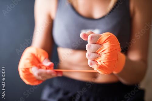 Fotografie, Obraz  Female Hands Wearing Boxing Bandages
