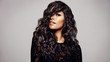 Leinwandbild Motiv Beautiful brunette with wavy hairstyle