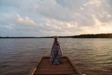Girl Standing On Dock While Su...