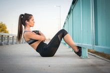 Young Sporty Woman Doing Sit U...