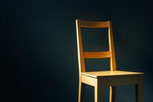 Empty Wooden Chair In Dark Room