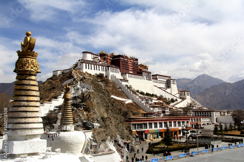 the panoramic of the Potala Palace, with the people republic of China flag inside as well as Potala Palace square, trees and meadow, Tibet Admiralty, golden chimes and Colored prayer