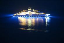 An Illuminated Luxury Yacht In...