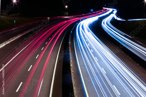 In de dag Nacht snelweg Speed Traffic - light trails on motorway highway at night, long exposure abstract urban background