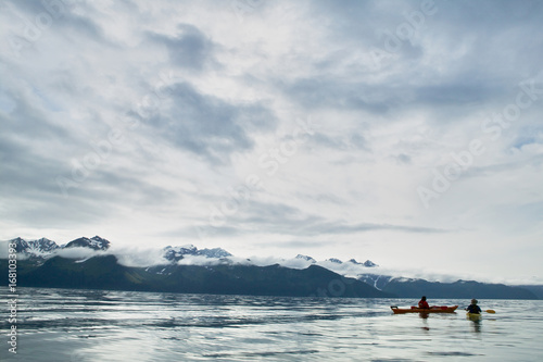 Valokuva  Two kayakers paddling at Prince William Sound, USA