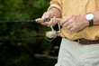 Man retrieving a lure while freshwater fishing