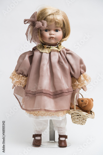 Photographie  Ceramic porcelain handmade doll with blond hair and pink dress