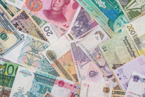 many different currency banknotes from world country as background Canvas Print