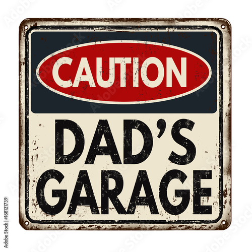 Valokuva Caution dad's garage vintage rusty metal sign
