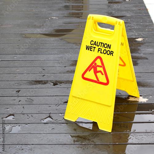 Fotografia  wet floor caution sign
