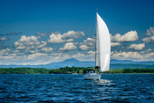 Sailboat On Lake Champlain In Front Of Camel's Hump Mountain