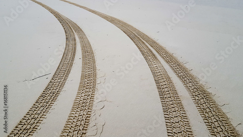 Tire tracks on the sand background