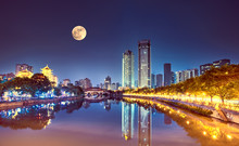 The Anshun Bridge Crosses The Jin River With The Moon In The Sky, Chengdu, China.