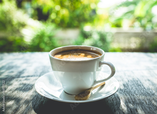 Staande foto Thee Capuccino, mocha, latte,americano, espresso hot coffee aroma in cup breakfast morning drink on wooden table vintage bar windows in cafe shop with newspaper restaurant background,copy space the left.