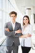 Confident business team of man and woman standing with crossed hands, team spirit concept, couple of success business people ready to act, business manager and employee,ready to implement plans