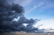 Dramatic atmosphere panorama view of storm clouds and sunset sky.