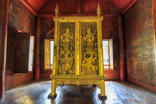 The ancient golden and black Tipitaka Book Cabinet Fototapeta