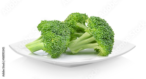 Broccoli in white plate on white background