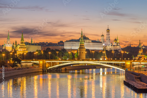 Illuminated Moscow Kremlin and Moscow River with bridge in the early summer morning. Russia