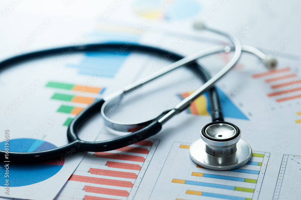 Fototapeta medical statistics and graphic charts with stethoscope