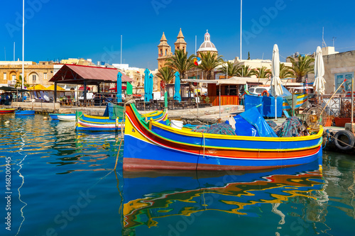 mata magnetyczna Traditional eyed colorful boats Luzzu in the Harbor of Mediterranean fishing village Marsaxlokk, Malta