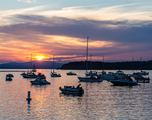 Boaters Watching The Sunset On...