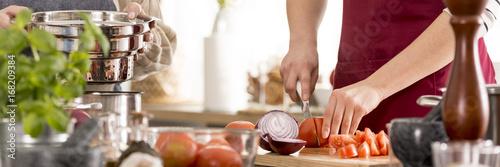 Foto auf Gartenposter Kochen Woman preparing tomato sauce