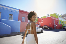 Trendy Young Woman Walking In The Street Turning To Camera