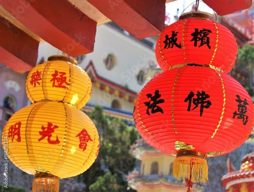 Recess Fitting Imagination Colourful Chinese Paper Lanterns Hanging from a Temple roof
